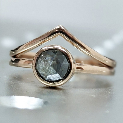 This hand made ring is crafted of the finest quality 14k gold. A Delicately Made Vintage Inspired Design with a beautiful brown / orange diamond set in a unique vintage designed bezel, adorned by a band of eternally connected diamonds on a textured band.